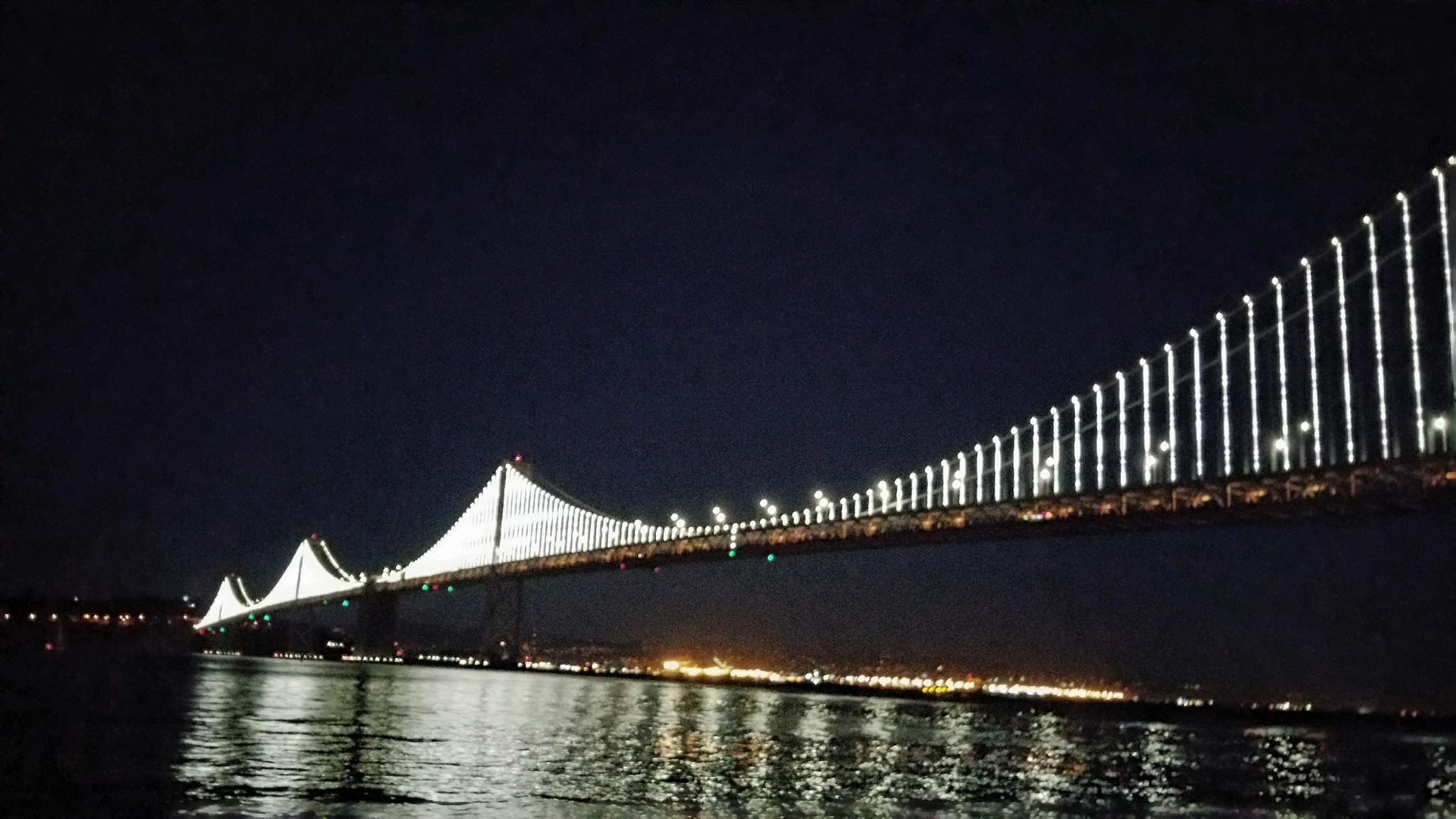 Bay Bridge lights at night, San Francisco.
