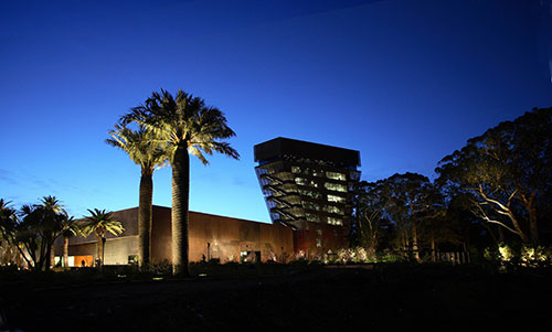 exterior view of de Young museum at night